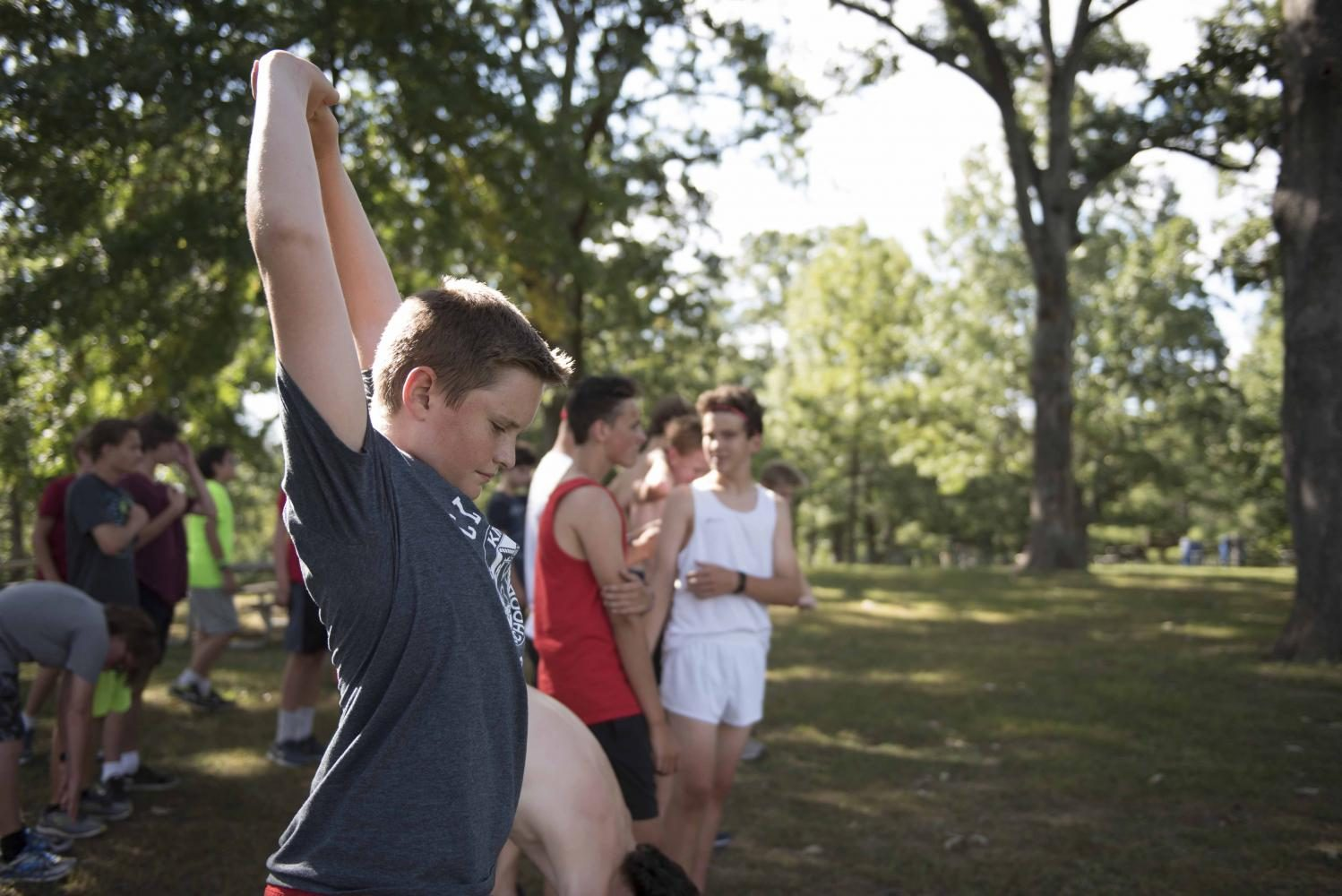 Charlie Stewart, freshman, warms up at cross country practice Sept. 7.