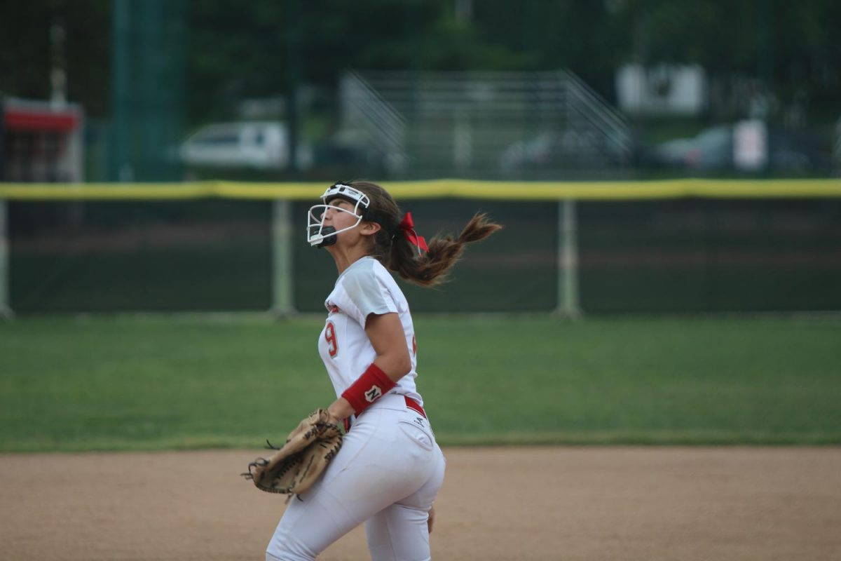 """Elsa Church, sophomore, practices pitching during warm-ups before a softball game against Parkway Central on September 27th. """"I love the people and the relationships you make, they just get so much stronger, on a different level than what you usually do with your other friends."""""""