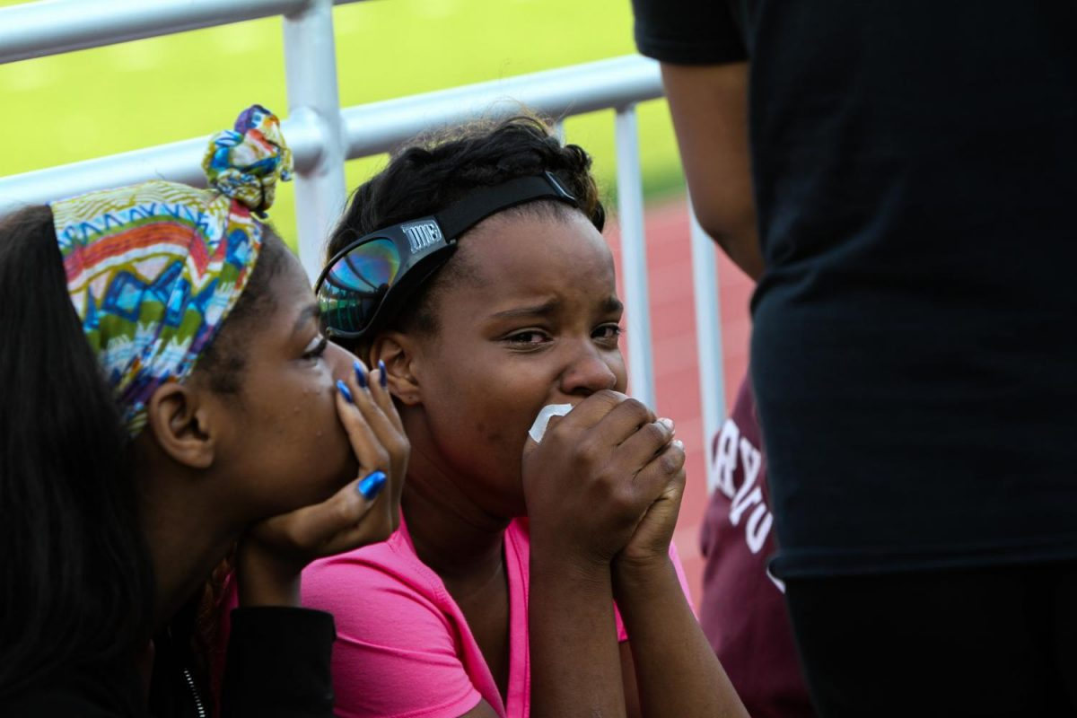 "Courtney Terry, sophomore, holds back tears at a student-led walkout at Lyons Stadium on Monday, September 18th, following the not-guilty verdict of St. Louis City Police Officer Jason Stockley. Terry was one of dozens of students who participated in the walkout, which featured student speeches about racial injustice. ""(The walkout) moved me and actually made me realize I've been through a lot of stuff and I should not have to go through it because of my color,"" said Terry."