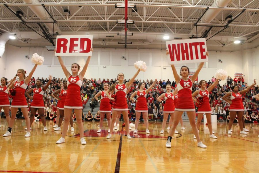 Finishing their cheer, the cheerleaders, cheer for Kirkwood with students, teachers, and the community at the Turkey Day Pep Rally Nov 21.