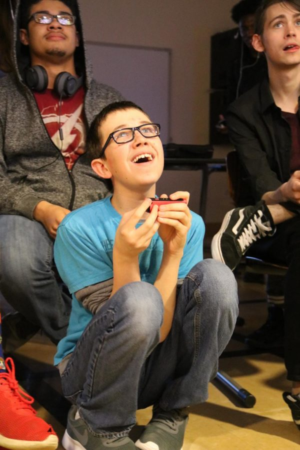 Focused on the game, Logan Bohner, freshman, smiles after eliminating an opponent during Gamers Club, Jan. 10