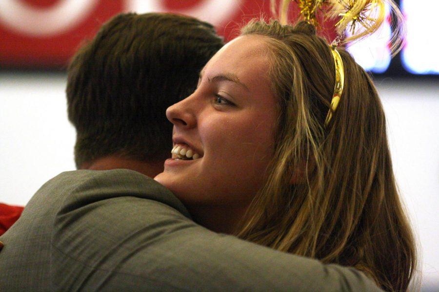 During the girls swim and dive senior night Bella Borbonus, senior, hugs her father Jan. 24.