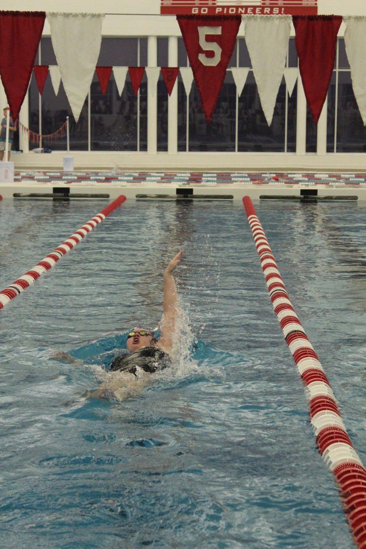 Competing+in+the+100+yard+backstroke%2C+junior%2C+Emma+Thurman+sprints+her+last+50m+at+the+Kirkwood+v.+Webster+swim+meet+Nov.+27.