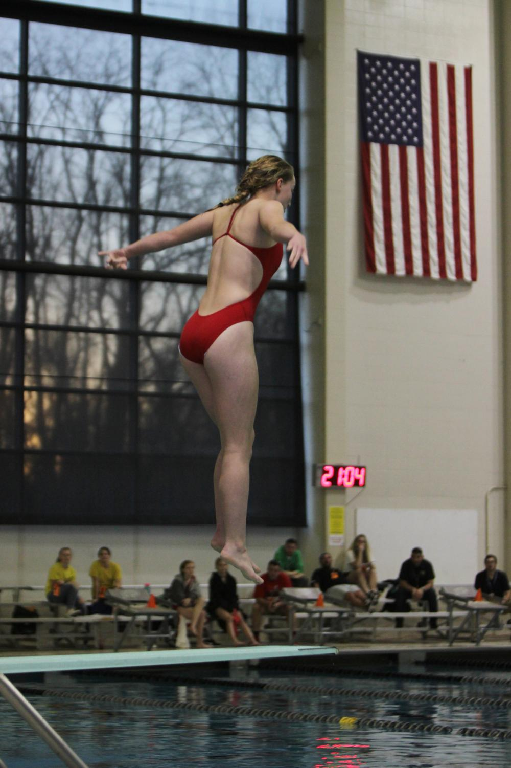 Beginning+her+first+dive%2C+Katie+Hastings%2C+sophomore%2C+springs+from+the+board+at+the+state+swim+and+dive+meet+Feb.+14.