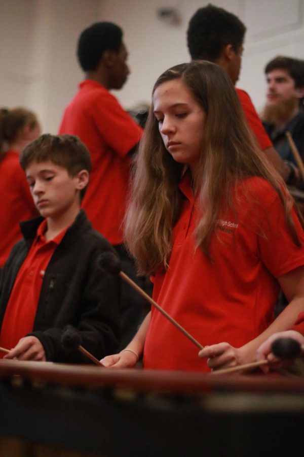 Playing the xylophone, Fiona Wilton, sophomore, and freshman, Trevor Kates focus on their instrument during the Turkey Day pep rally Nov. 21