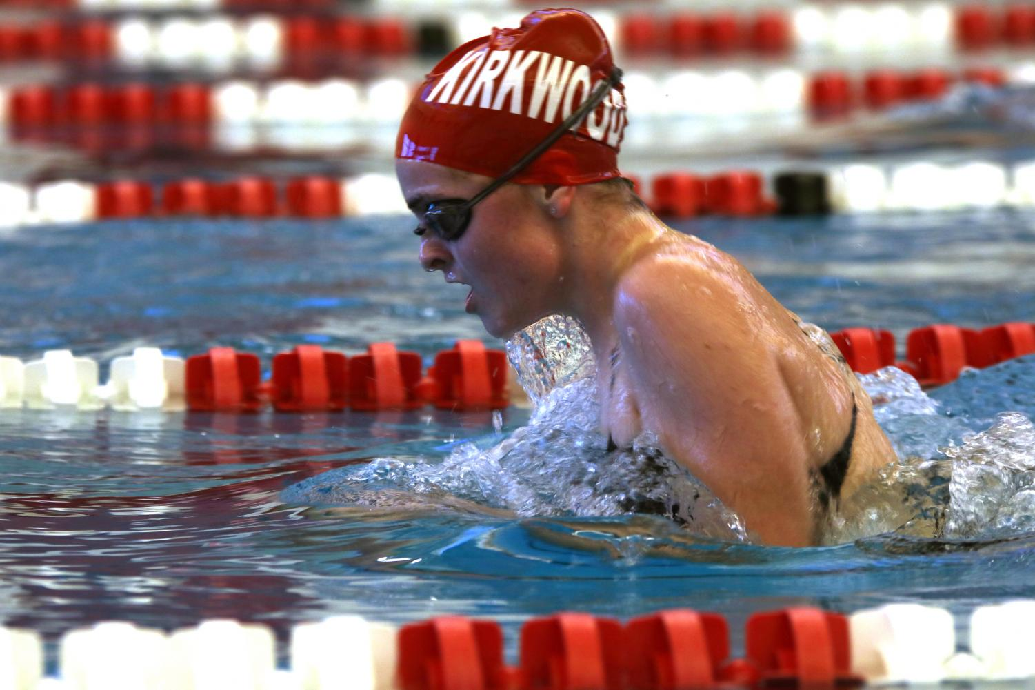 Swimming+breast+stroke+in+the+IM%2C+Paige+Howell%2C+sophomore%2C+lifts+her+head+to+breathe+as+she+begins+the+transition+into+free+stroke+at+the+Senior+Night+swim+meet+Jan.+24.+