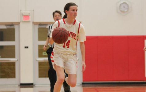 During the girls' JV basketball game, Grace Hupp, freshman, takes the ball up the court Jan. 15.