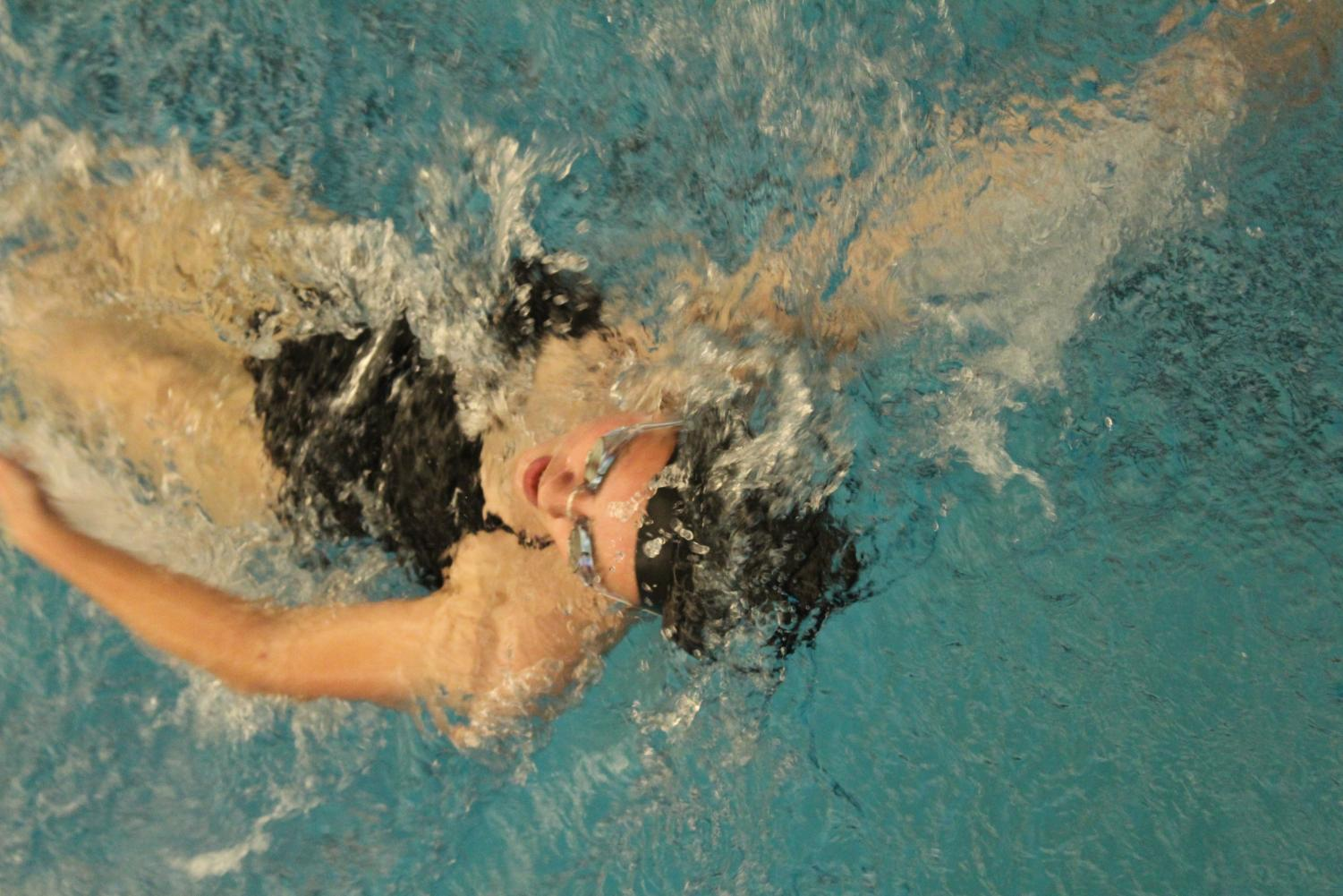 Swimming+into+the+finish%2C+Paige+Howell%2C+sophomore%2C+takes+her+last+few+strokes+in+the+100m+backstroke+Nov.+27.%0A