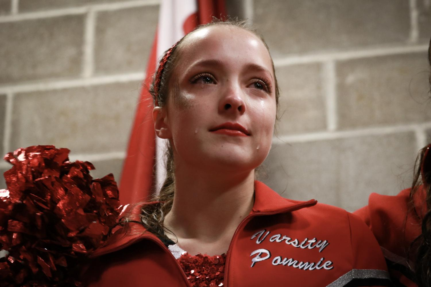 Giving+a+pep+talk+to+her+team%2C+Maria+Ginocchio%2C+senior%2C+cries+before+her+final+home+football+game+dancing+as+a+KHS+pommie+Oct.+26