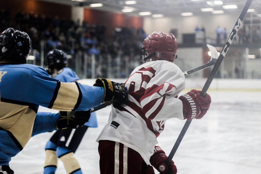 Playing in the Quarter Final game against SLUH, Seamus Campbell, junior, gets pulled by the other team Feb. 23.