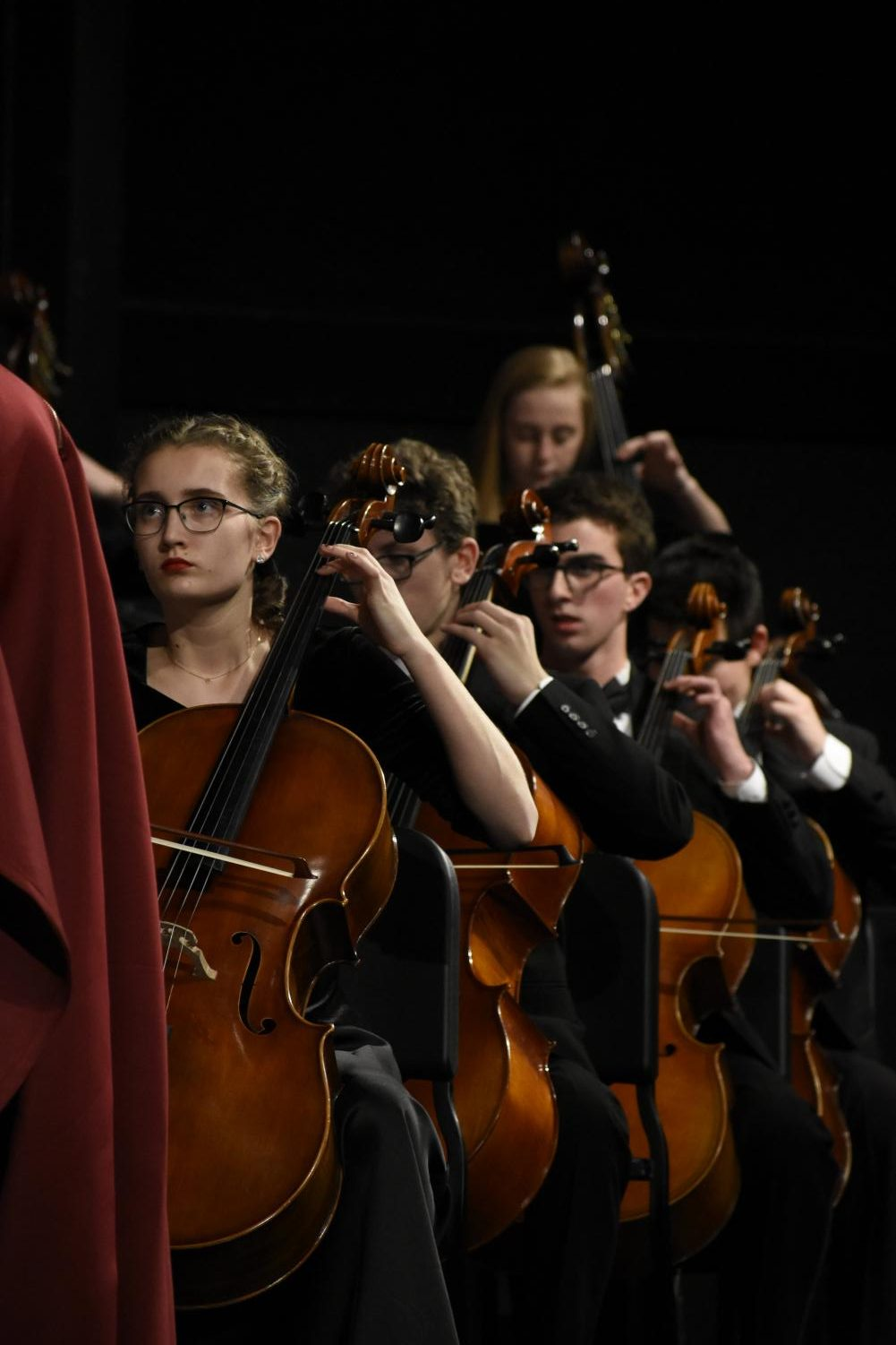 Looking+up+at+the+conductor%2C+Abby+Dickinson%2C+junior%2C+plays+her+cello+at+the+orchestra+concert+Dec.+6.+