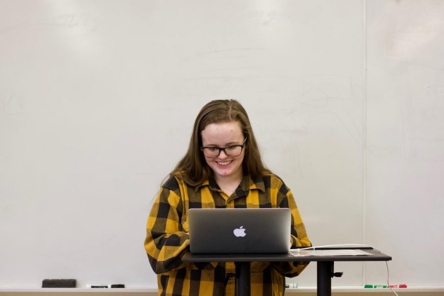 Looking up information on 2019 Senate Bills, Makenna Chappell, junior, smiles during a GSA club meeting Jan. 15.