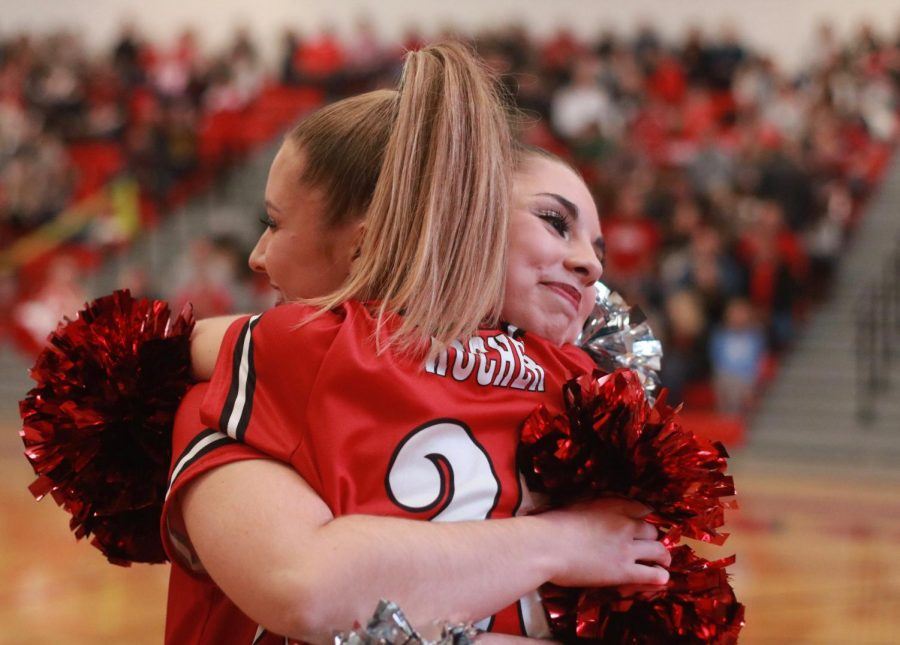 About to start dancing, Malayna Vines, senior, and Lindsay Kocher, junior, hug before Malayna's last pep rally Nov. 21.
