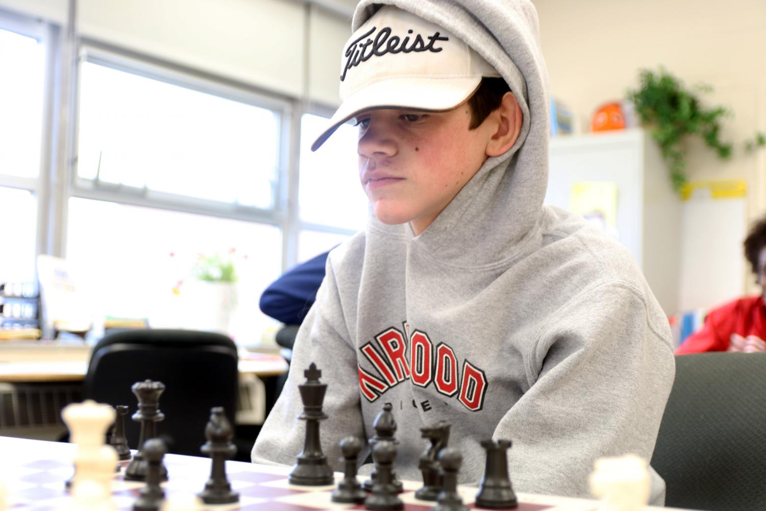 As+Cameron+Schulze%2C+freshman%2C+stares+at+the+chessboard%2C+he+debates+in+his+head+the+next+move+he+will+make.+Jan.+24.+
