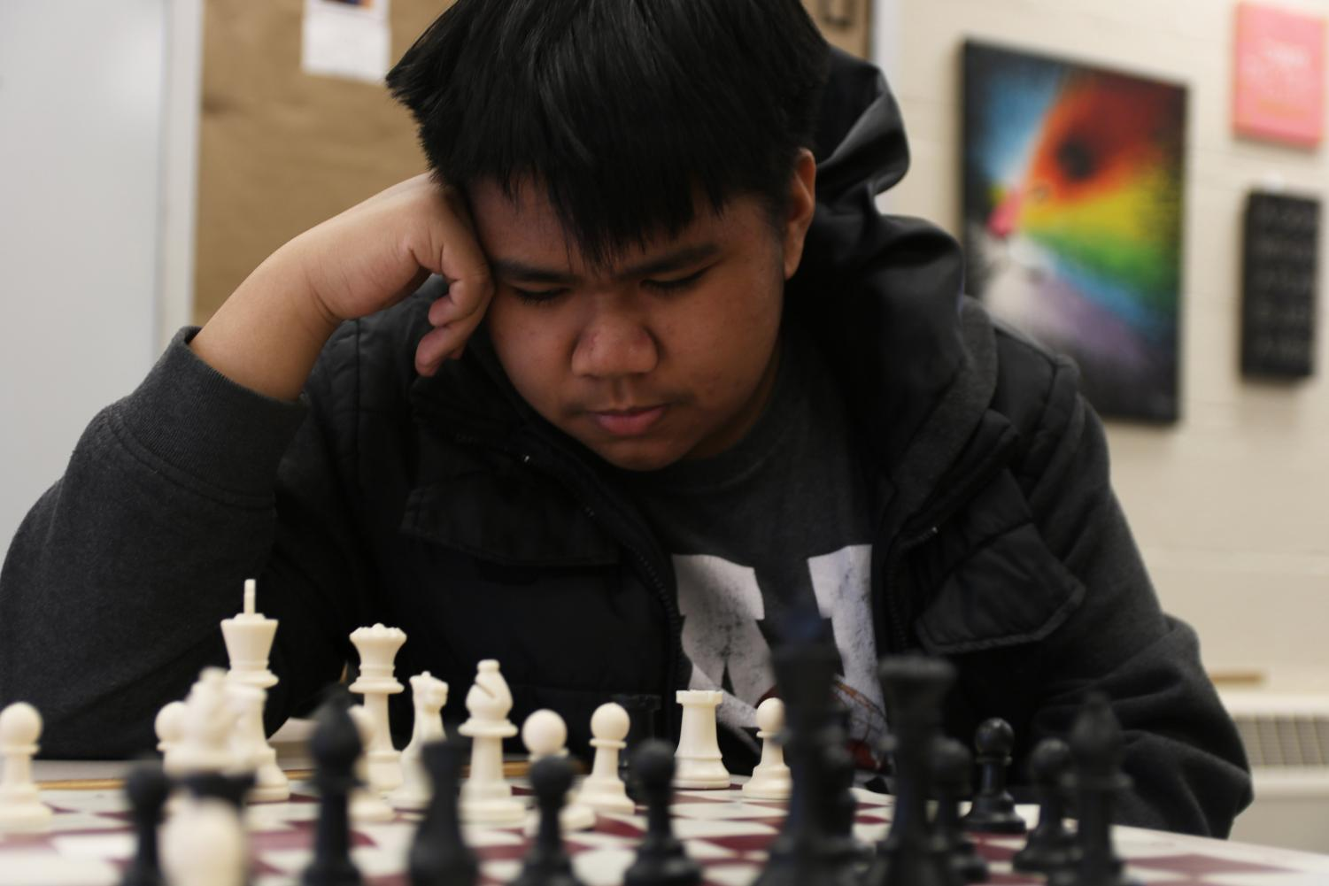 Contemplating+his+next+move%2C+Ron+Almira%2C+junior%2C+focusses+on+the+chess+pieces+at+chess+club+Jan.+24.+