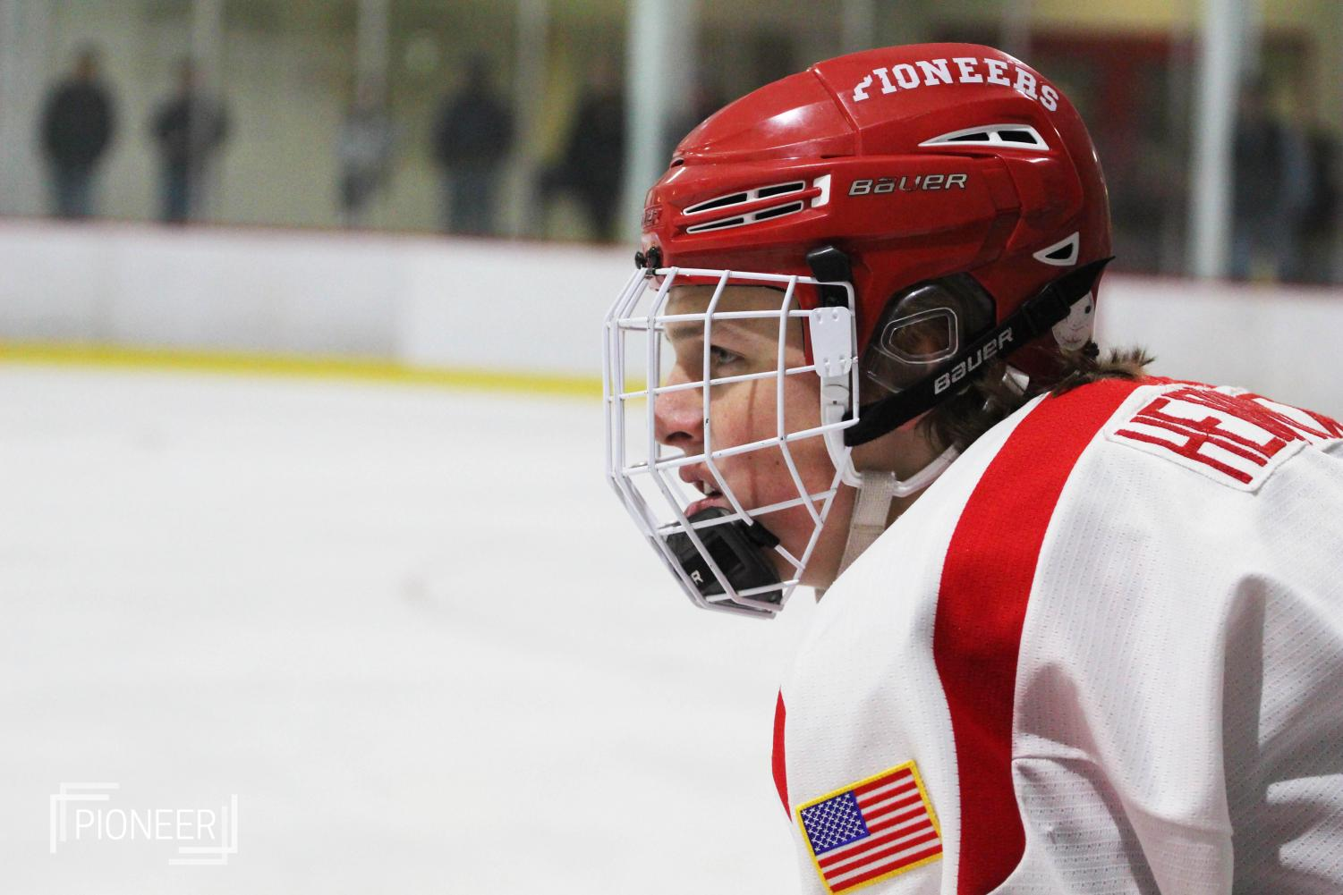 In+a+competitive+game+against+CBC%2C+Andrew+Kruszka%2C+sophomore%2C+keeps+the+puck+away+from+his+opponent+Dec.+1