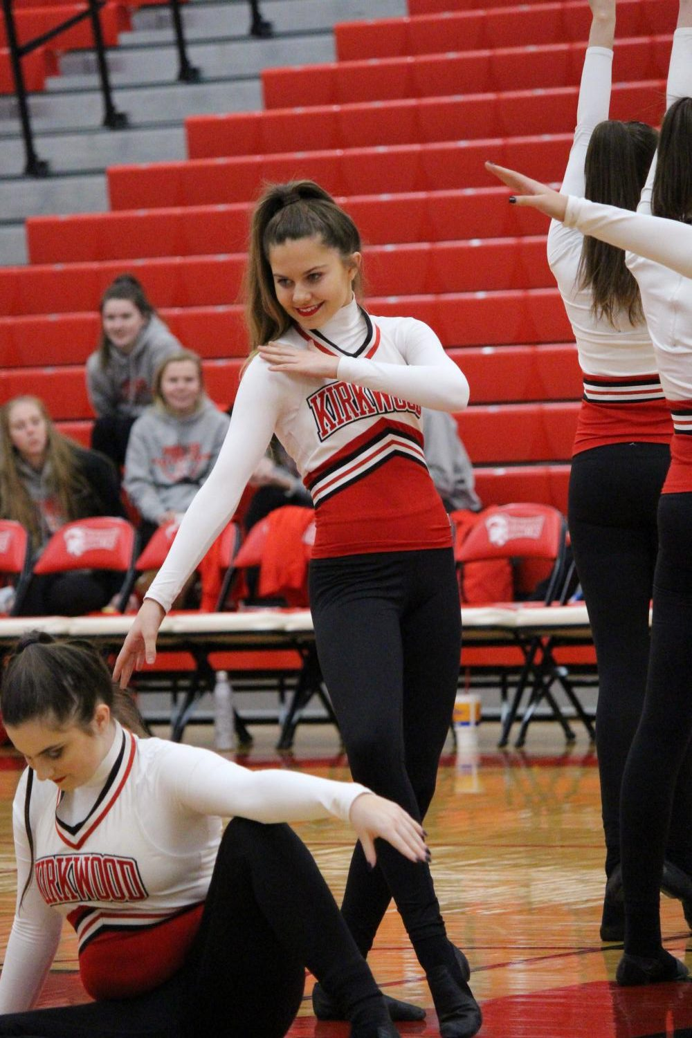 During+the+pommies+halftime+show+at+the+girls+JV+basketball+game+Maddie+Schmidt%2C+freshman%2C+strikes+a+pose+Jan.+3.