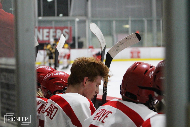 During+the+varsity+hockey+game%2C+Austin+Cleveland%2C+senior%2C+sits+on+the+bench+waiting+to+play+Nov.+17