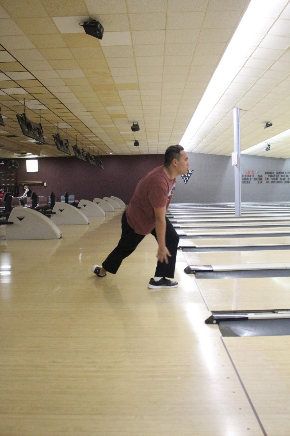 During+bowling+practice%2C+Noah+Herschel%2C+senior%2C+holds+his+pose+after+bowling+a+strike+Feb.+19.