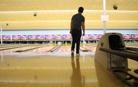 During bowling practice, Jason Hoffarth, junior, stares his ball down as he bowls a spare Feb. 19.