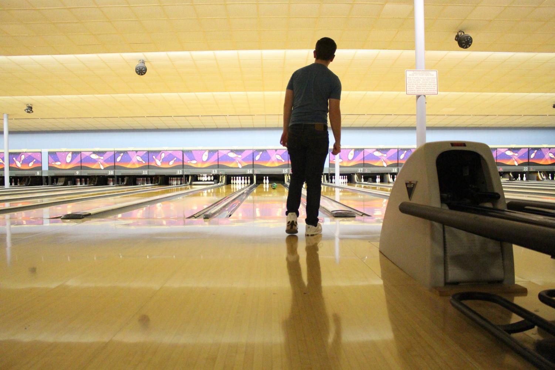 During+bowling+practice%2C+Jason+Hoffarth%2C+junior%2C+stares+his+ball+down+as+he+bowls+a+spare+Feb.+19.+