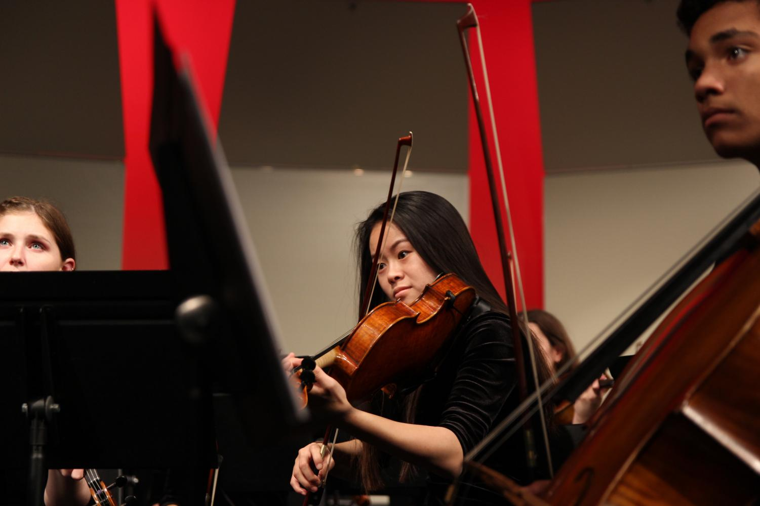 With+her+viola+tucked+under+her+chin%2C+Molly+Prow%2C+junior%2C+performs+at+the+winter+orchestra+concert+Dec.+6.+