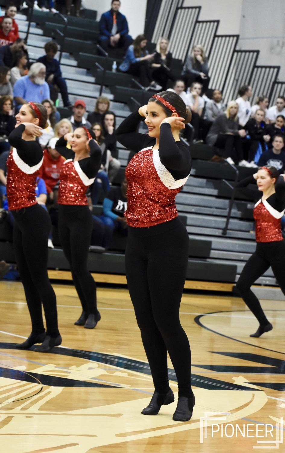 +Performing+at+a+dance+competition%2C+Sara+Mattingly%2C+junior%2C+smiles+at+the+crowd+Dec.+1.%0A%0A