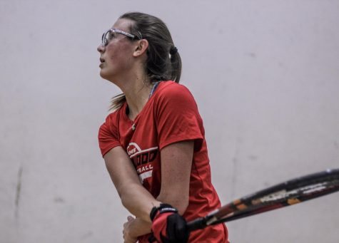 Watching the ball, Alice Reider, senior, competes in a racquetball tournament Feb. 17.