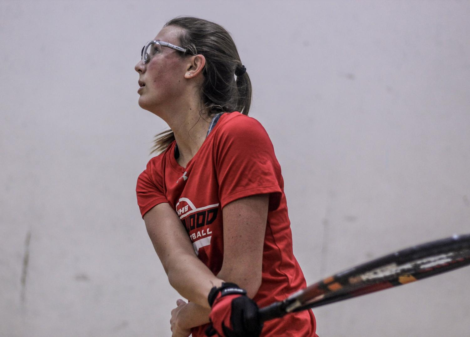 Watching+the+ball%2C+Alice+Reider%2C+senior%2C+competes+in+a+racquetball+tournament+Feb.+17.