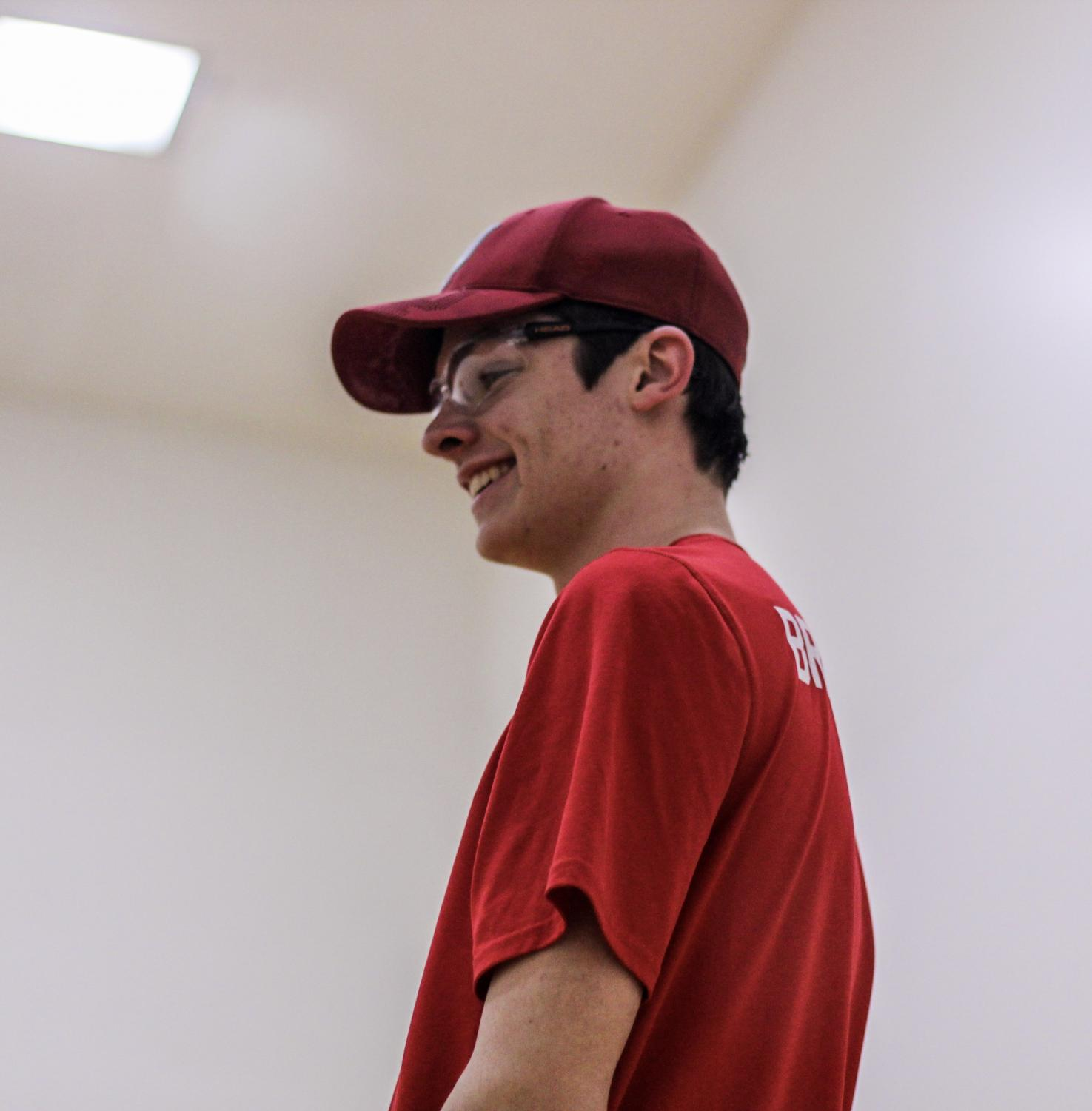 Smiling+between+serves%2C+Grant+Branstetter%2C+senior%2C+competes+in+a+racquetball+tournament+Feb.+20.
