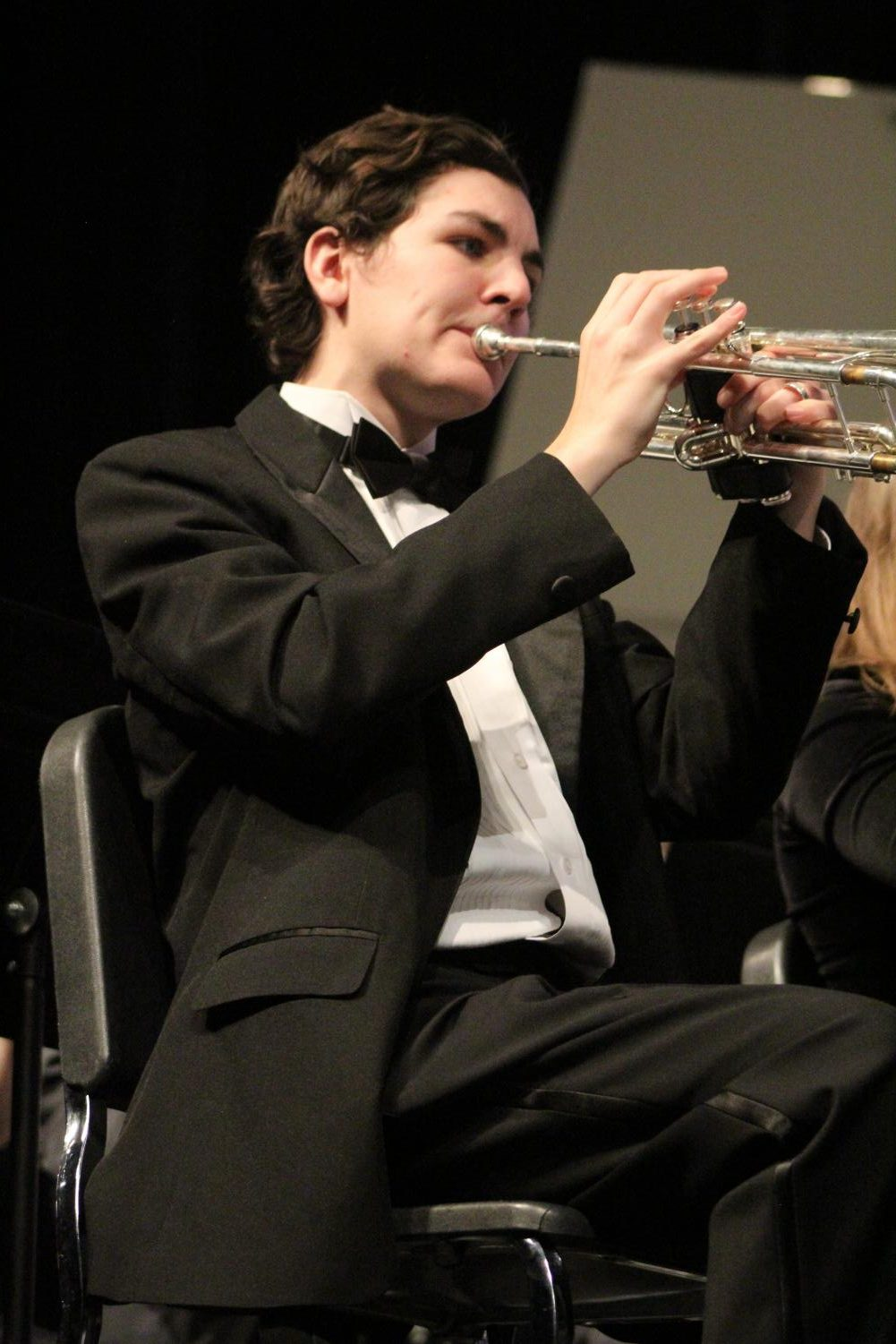 While+sitting+first+chair%2C+Clark+Woodruff%2C++junior%2C++plays+the+trumpet+at+the+winter+band+concert+Feb.+28.%0A