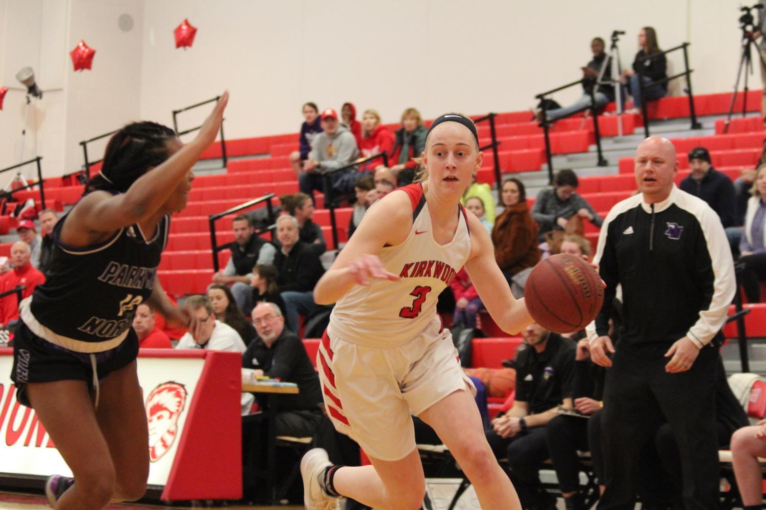 During+the+girls%E2%80%99+varsity+basketball+game%2C+Natalie+Bruns%2C+junior%2C+drives+past+the+defender+to+get+to+the+basket+Feb.+8.+%0A