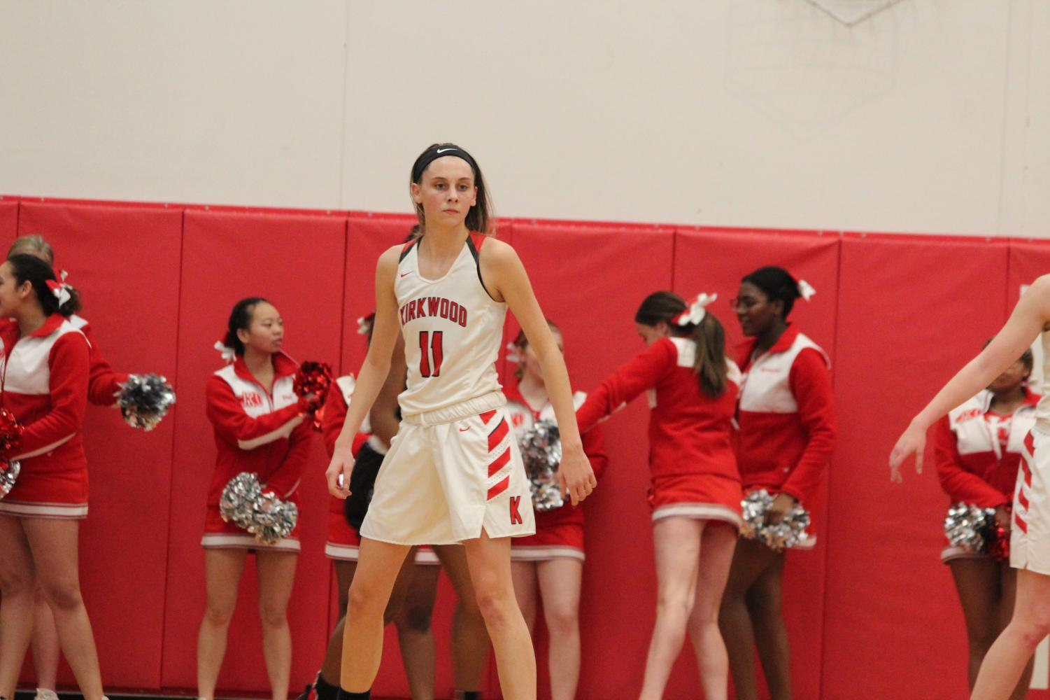 During+a+varsity+girls%E2%80%99+basketball+game%2C+Rylee+Mulvaney%2C+junior%2C+waits+for+the+play+to+develop+while+on+defence+Feb.+8.