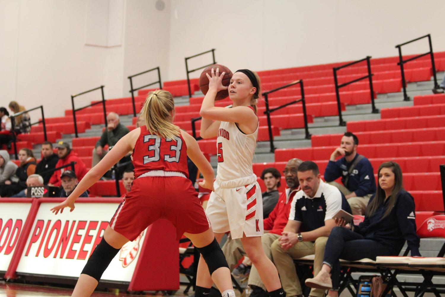 During+a+varsity+girls%E2%80%99+basketball+game%2C+Olivia+Giardino%2C+junior%2C+looks+to+find+an+open+teammate+Feb.+12.