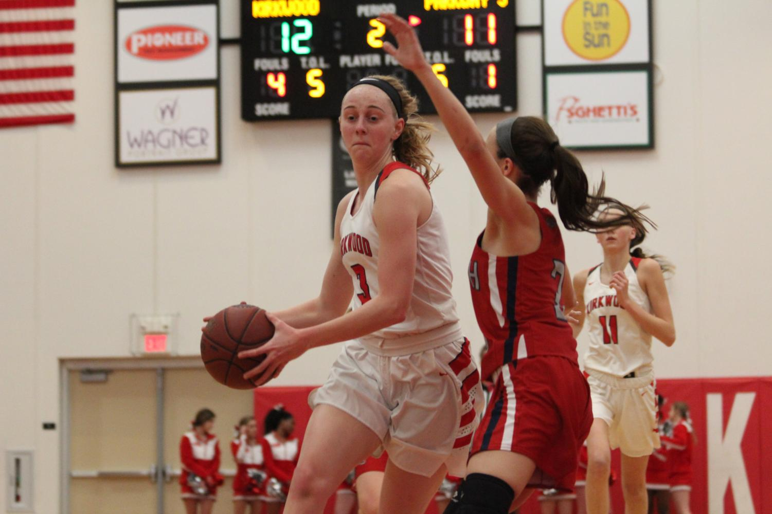 During+the+girls%E2%80%99+basketball+game%2C+Natalie+Bruns%2C+junior%2C+drives+past+the+defender+to+get+to+the+basket+Feb.+12.