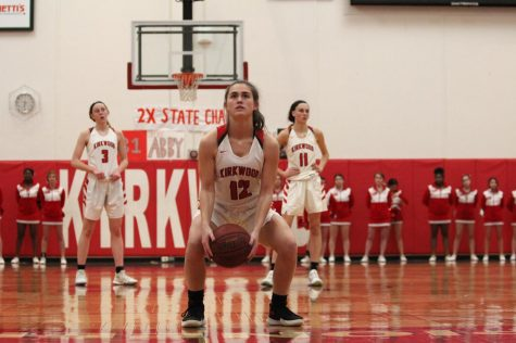 During a girls' varsity basketball game, Kate Jozwiakowski, junior, shoots a free throw after a foul Feb. 14.