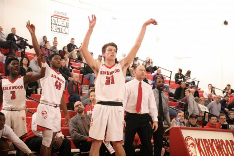 Jonah McDowell, senior, shoots a 3-point shot from the corner on Senior Night Feb. 21.