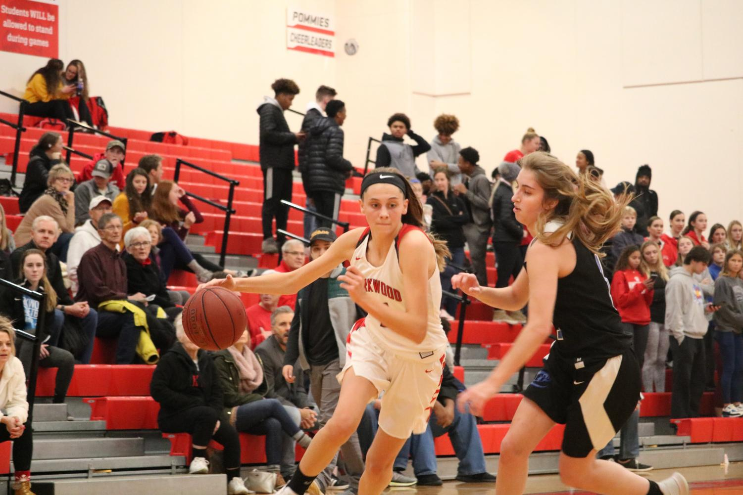 Rylee+Mulvaney%2C+junior%2C+dribbles+the+ball+down+the+court+against+her+Ladue+High+School+opponent+Dec.+15.+