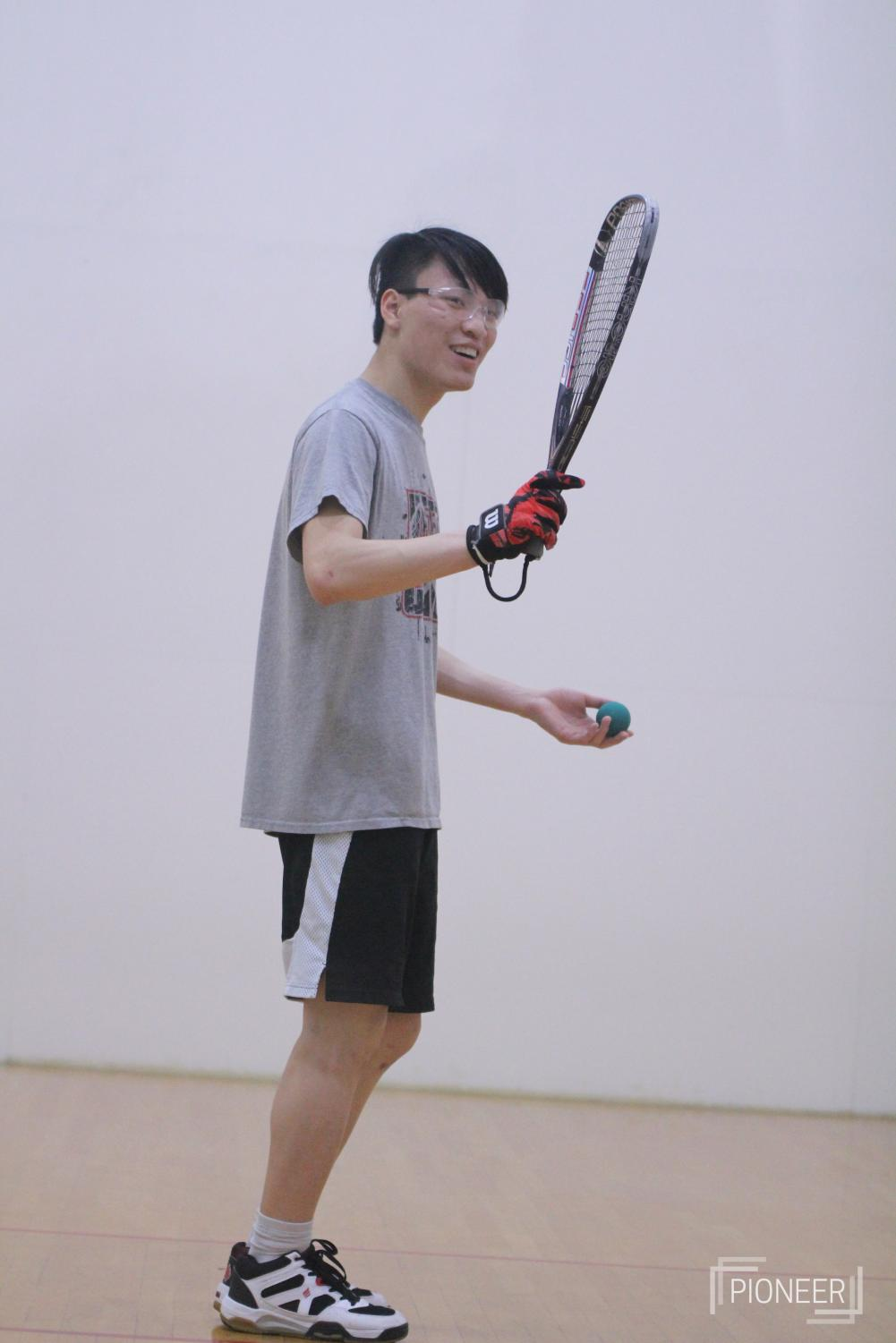 Lifting+his+racket%2C+Liam+Justin%2C+senior%2C+prepares+to+serve+the+ball+at+racquetball+practice+Feb.+11.%0A