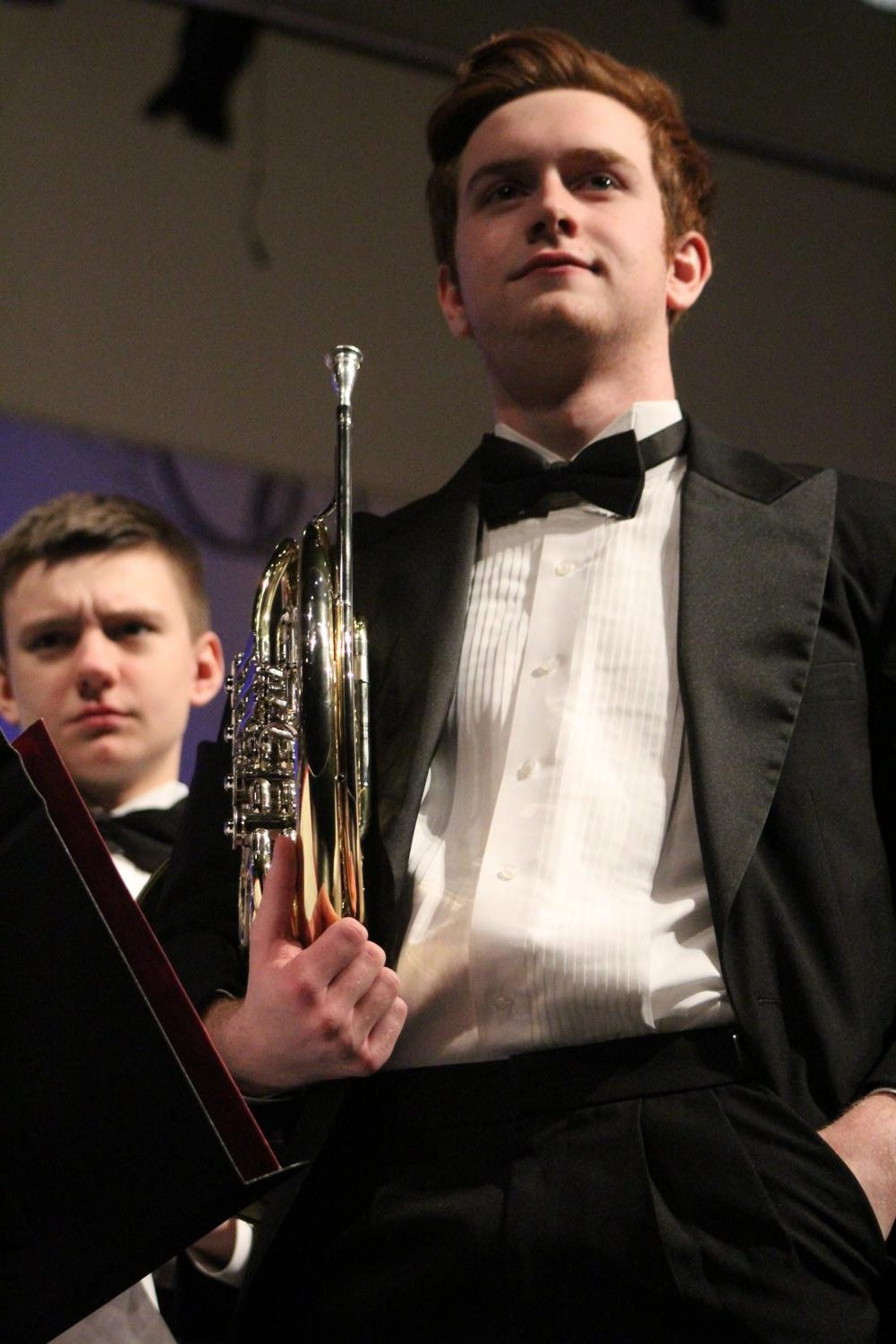 Standing+up+after+his+performance%2C+Leo+Bartin%2C+sophomore%2C+is+applauded+by+the+audience+at+the+band+concert+Feb.+28