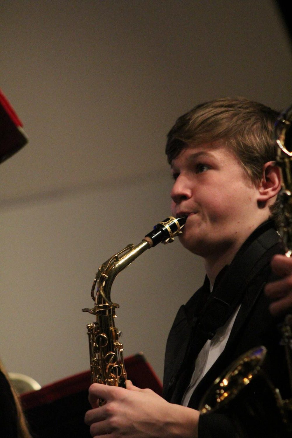 Paying+attention+to+his+conductor%2C+Ryan+Clutes%2C+freshman%2C+plays+his+saxophone+during+the+final+song+at+the+winter+band+concert+Feb.+28+