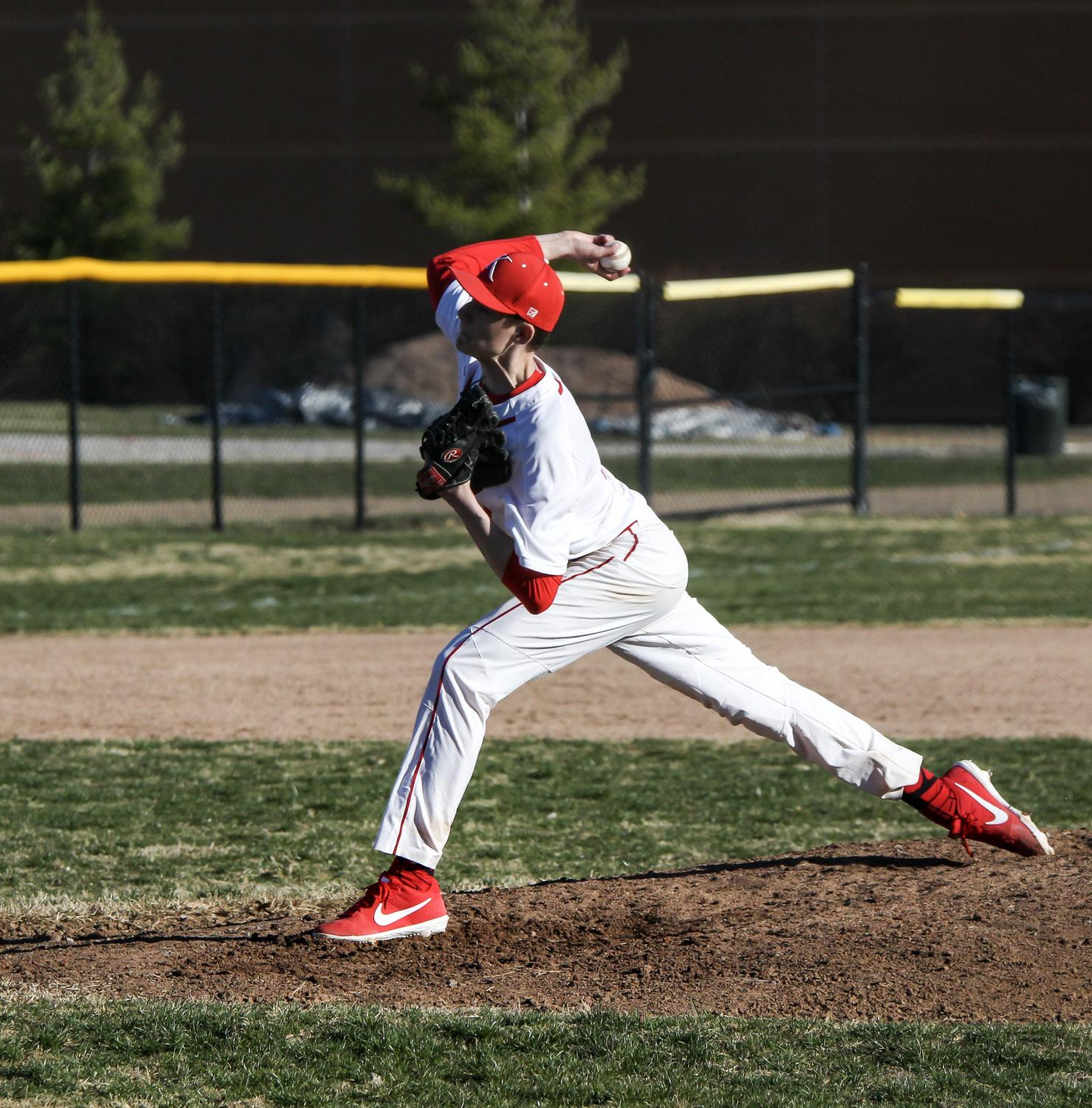 +Pitching+the+ball%2C+Kannon+Nesslage%2C+sophomore%2C+throws+a+4-seam+fastball+during+a+game+against+Ritneour+High+School+Mar.+22.%0A