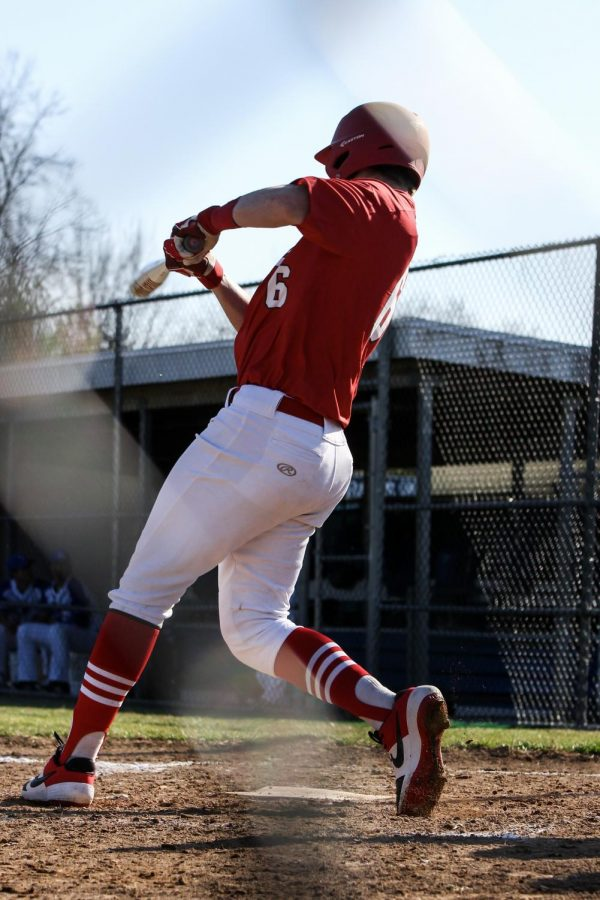 Taking a step, Tate Howell, senior, hit the ball to right field and gets a single run  against the Ladue Rams Mar. 26.
