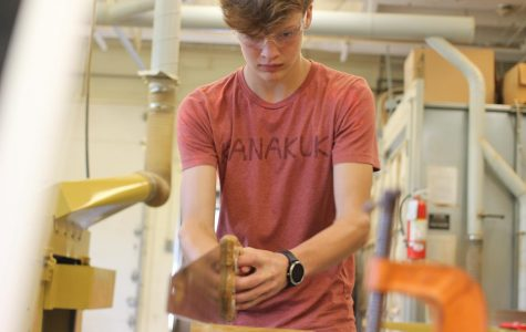 Shrinking his wood sample, Ethan McGinnis, sophomore, refines the size of his project Sept. 4.