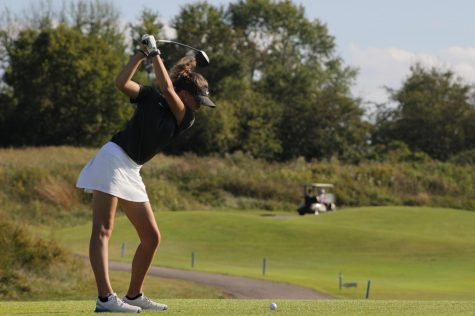 Swinging the club, Riley Forinach, sophomore, shoots her first stroke at Aberdeen Golf Club, Sept. 30.