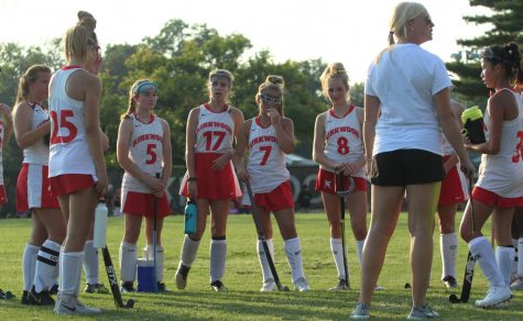 Listening intently to their coach's instruction, the JV field hockey girls discuss their game plan for their match against Cor Jesu Sep. 3.