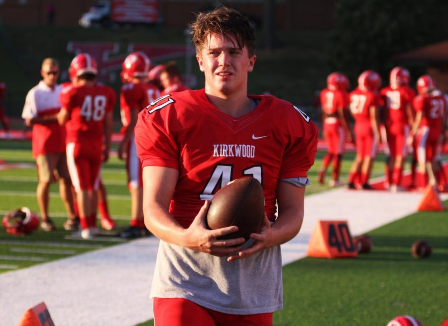 Clutching+the+football%2C+junior%2C+Blaine+Anderson%2C+gazes+out+into+the+field+in+preparation+for+his+game+against+Pattonville+Sep.+27.%0A