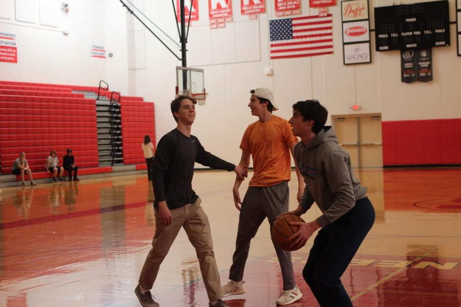 On a mini field trip for yearbook, Eddie Killeen, Connor Wood and Paul Goessling, seniors, play basketball  Jan. 8.