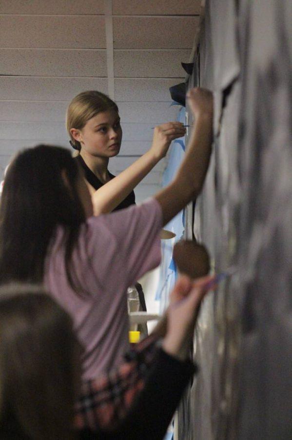 Painting the wall, Audrey Turley, freshman, decorating the freshman hallway for turkey day Nov. 25.