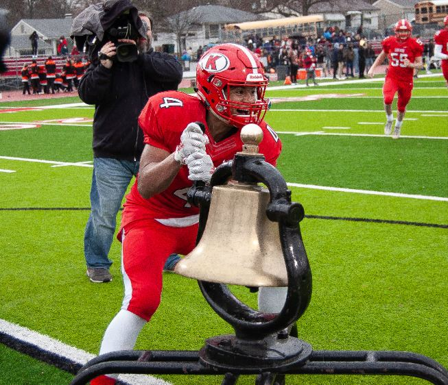After defeating Webster in the thanksgiving football game, Cameron Macon, senior, rings the Frisco Bell as his classmates flood the field to celebrate victory. This will be the 7th year in a row that the Frisco Bell will stay in Kirkwood's name.